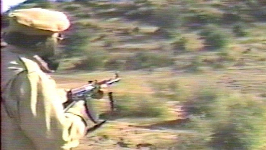 Gilani, who is believed to be in his eighties, fires a weapon in a training video made by Muslims of the Americas. (Christian Action Network)