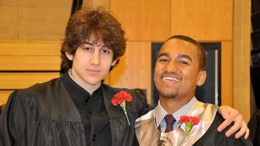 FILE - In this undated photo provided by Robin Young, Dzhokhar A. Tsarnaev, left, and Here & Now host Robin Young's nephew, right, pose for a photo after graduating from Cambridge Rindge and Latin High School. Tsarnaev was about 9 when he came to the United States from the Russian Caucasus region. He was more integrated in daily American life than his older brother, according to accounts from friends and relatives. (AP Photo/Robin Young)