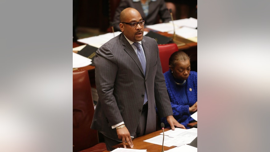 FILE - In this file photo of Feb. 11, 2013, Sen. John Sampson, D-Brooklyn, speaks in the Senate in Albany, N.Y. Sampson was arrested Monday, May 6, 2013, by the FBI in the latest corruption case brought by federal prosecutors. The Brooklyn Democrat was to appear later in the day at a Brooklyn courthouse. Specific charges weren't immediately announced. (AP Photo/Mike Groll, File)