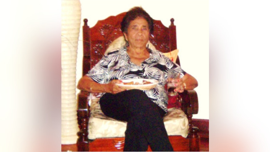 This image provided by the Metropolitan Washington Airports Authority shows an undated image of Victoria Kong, 83. Kong was last seen after arriving at Ronald Reagan Washington National Airport Friday May 3, 2013 walking north on the Mount Vernon trail toward Gravelly Point. Mrs. Kong is an Asian female from Barbados and has fair/light skin tone. She was last seen wearing a long purple/brown dress with a flower design and wearing sandals. (AP Photo/Metropolitan Washington Airports Authority)