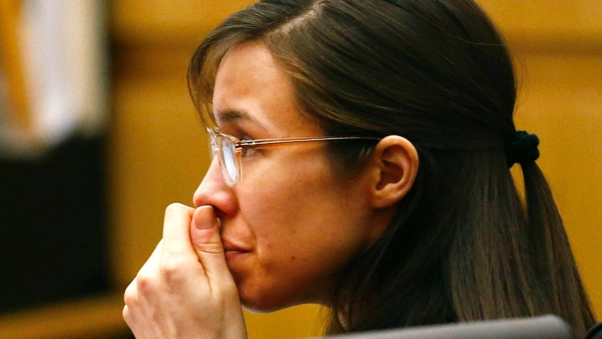 Defendant Jodi Arias listens to defense attorney Kirk Nurmi make his closing arguments during her trial on Friday, May 3, 2013 at Maricopa County Superior Court in Phoenix.  Arias is charged with first-degree murder in the stabbing and shooting death of Travis Alexander, 30, in his suburban Phoenix home in June 2008. (AP Photo/The Arizona Republic, Rob Schumacher, Pool)