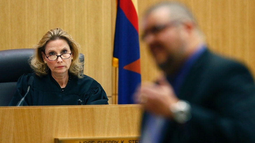 Judge Sherry Stephens listens to defense attorney Kirk Nurmi during closing arguments during Jodi Arias' murder trial on Friday, May 3, 2013 at Maricopa County Superior Court in Phoenix.  Arias is charged with first-degree murder in the stabbing and shooting death of Travis Alexander, 30, in his suburban Phoenix home in June 2008. (AP Photo/The Arizona Republic, Rob Schumacher, Pool)