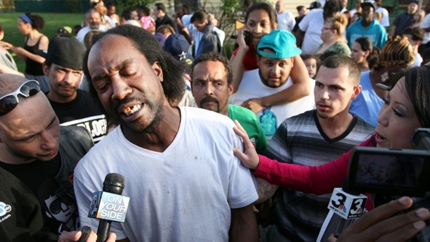 May 6, 2013: Neighbor Charles Ramsey speaks to media near the home on the 2200 block of Seymour Avenue, where three missing women were rescued in Cleveland.