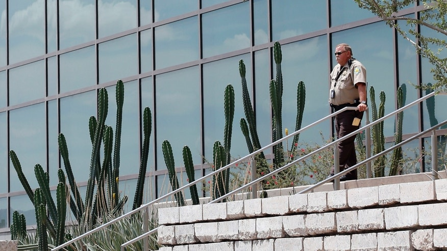 A Maricopa County Sheriff's Deputy stands outside Superior Court, Wednesday, May 8, 2013 in downtown Phoenix. Jurors reached a verdict Wednesday in the trial of Jodi Arias, who is accused of murdering her one-time boyfriend in Arizona.  Arias is charged with first-degree murder in the June 2008 death of Travis Alexander, a motivational speaker and salesman, at his suburban Phoenix home.  (AP Photo/Matt York)