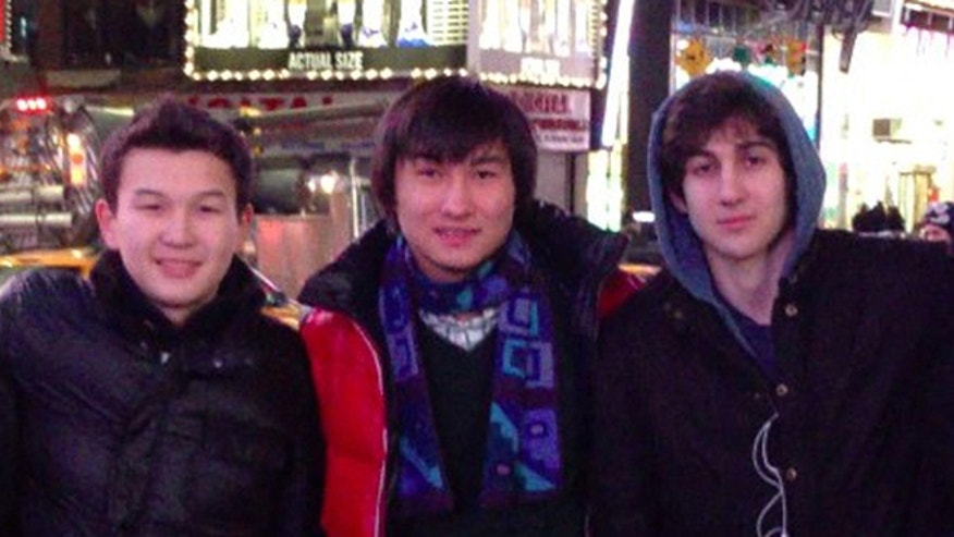 This undated photo added on April 18, 2013 to the VK page of Dias Kadyrbayev shows, from left, Azamat Tazhayakov and Dias Kadyrbayev, from Kazakhstan, with Boston Marathon bombing suspect Dzhokhar Tsarnaev in Times Square in New York. Kadyrbayev and Tazhayakov, two college buddies of Tsarnaev, were jailed by immigration authorities for violating their student visas by not regularly attending classes.