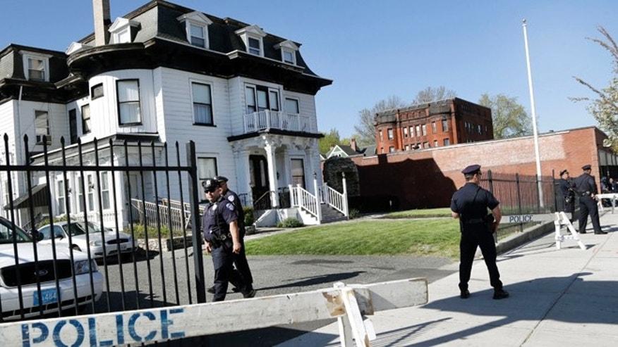 May 6: Police keep watch outside Graham, Putnam, and Mahoney Funeral Parlors in Worcester, Mass., where the body of killed Boston Marathon bombing suspect Tamerlan Tsarnaev is being prepared for burial.
