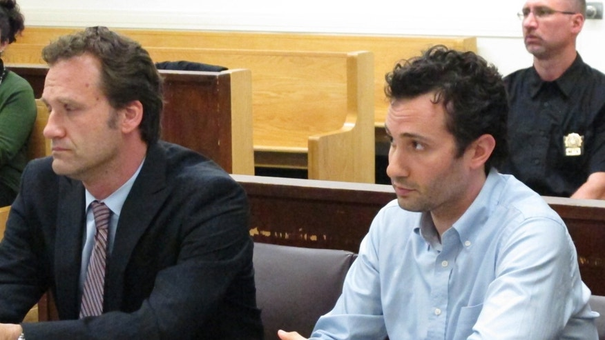 Former Fox News employee Joseph Muto (r.) and attorney Florian Meidel (l.) appear in court where Muto admitted his role in posting stolen video on a website. (Fox News)