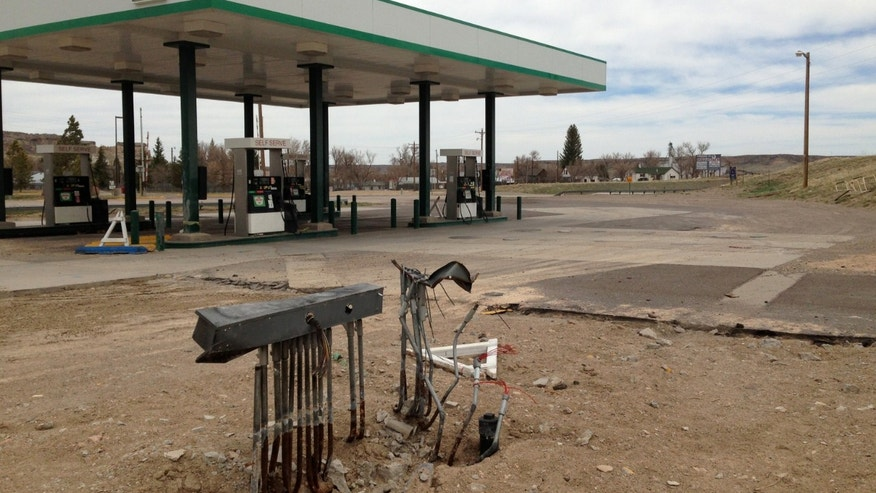 This April 29,2013 photo shows all that remained of the Horton's Corner convenience store, foreground in Chugwater, Wyo., after a Dec. 30, 2012 fire caused by a sport utility vehicle that crashed into the store. Horton's Corner was the only place for miles around to get gas or groceries and may not be rebuilt for several months yet. (AP Photo/Mead Gruver)
