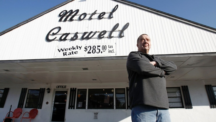 Russell Caswell stands outside the Tewksbury, Mass., motel that local, state and federal authorities tried to seize. (AP File)