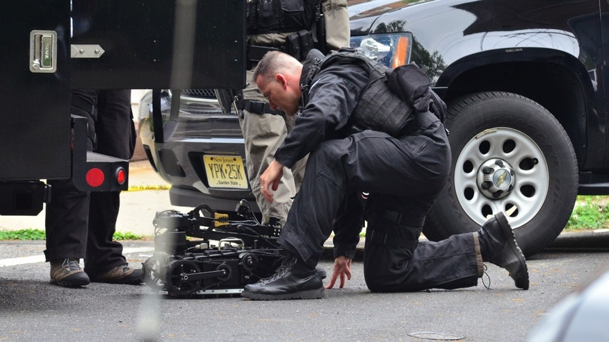 May 10, 2013: A state police swat team member readies a robot to enter a home where a man had barricaded himself in Trenton, N.J.