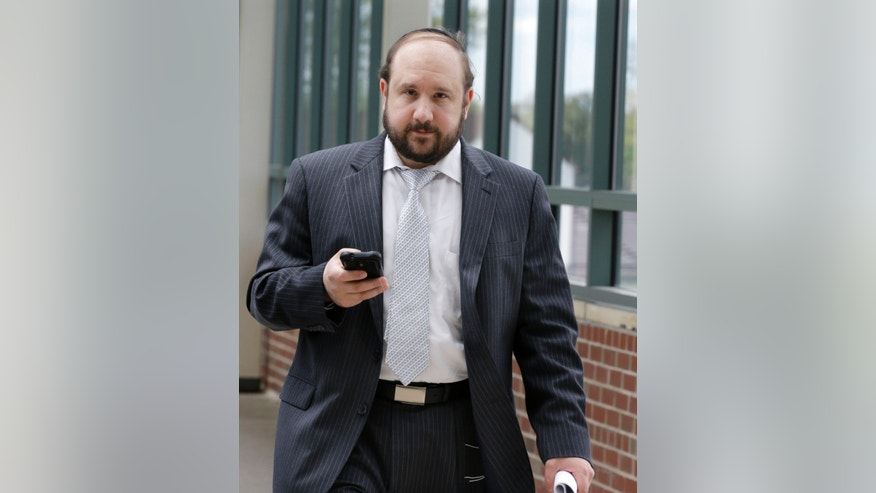 Yosef Kolko, 39, walks near the Ocean County Courthouse in Toms River, N.J., Thursday, May 9, 2013, during a break in his trial on sexual assault charges. Testimony continues in the trial of the yeshiva teacher accused of sexually abusing a boy at a summer camp where he was a counselor. Prosecutors say the boy's parents were pressured by members of their Orthodox Jewish community to drop the charges and let a rabbinical court deal with them. (AP Photo/Mel Evans)