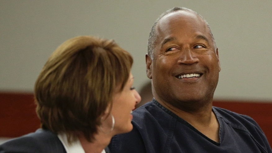 May 13, 2013: O.J. Simpson, right, talks with his attorney, Patricia Palm, in Clark County District Court in Las Vegas. (AP)