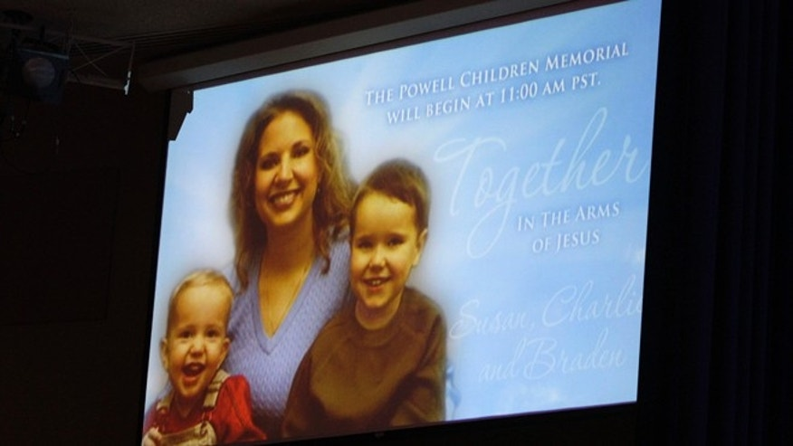 A picture of Susan Powell is seen on a screen with her children Charles (R) and Braden Powell during funeral services for the boys in Tacoma, Washington February 11, 2012.