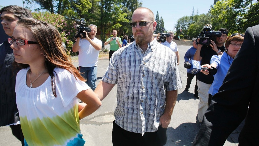 Barney Fowler, the father of murder victim Leila Fowler, leaves the Calaveras County Courthouse after the arraignment of his 12-year-old son for the murder of  Leila, in San Andreas, Calif., Wednesday, May 15, 2013.  Leila Fowler, 8, was stabbed to death in her Valley Springs home, last month.  The defendant was charged with second-degree murder and a special allegation for use of a dangerous weapon for the death of Leila Fowler. No plea was entered. (AP Photo/Rich Pedroncelli)