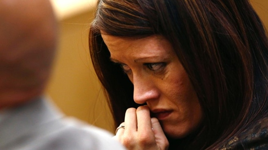 May 15, 2013: Tanisha Sorenso turns away as autopsy photos of her brother Travis Alexander are displayed during the sentencing phase of the Jodi Arias murder trial at Maricopa County Superior Court in Phoenix.