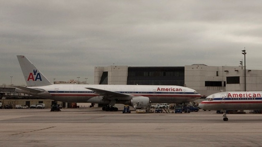 American Airlines planes taxi past a terminal at Miami International airport in Miami, Florida.