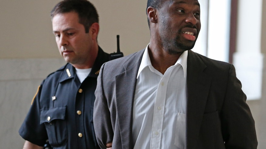 April 16, 2013: This photo in Cincinnati shows Ricardo Woods being taken from court after he was found guilty in the shooting death of a man who authorities say identified his assailant by blinking his eyes while paralyzed.