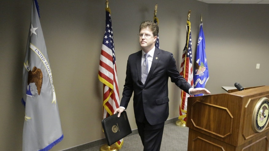 U.S. Attorney David B. Barlow, of Utah, walks off following an interview at his office Thursday, May 16, 2013, in Salt Lake City.  U.S. authorities in Idaho said they have arrested Fazliddin Kurbanov, a man from Uzbekistan accused of conspiring with a designated terrorist organization in his home country and helping scheme to use a weapon of mass destruction. (AP Photo/Rick Bowmer)