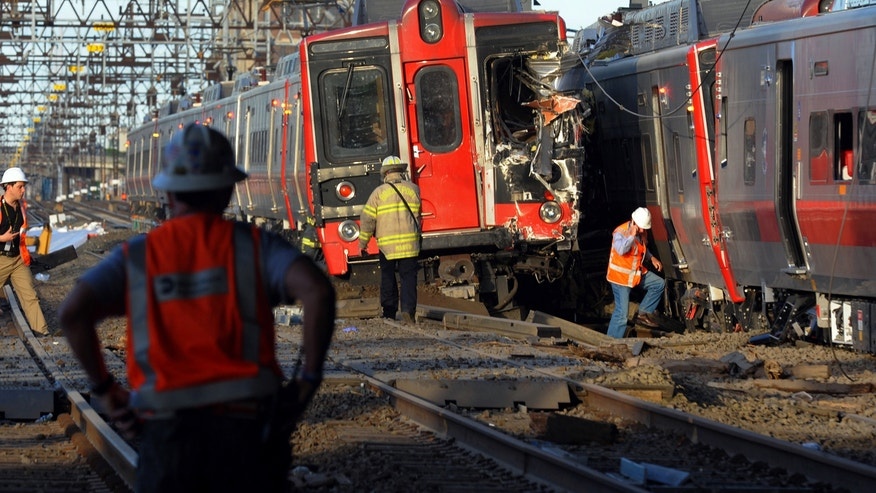 May 17, 2013 : Emergency personnel work at the scene where two Metro North commuter trains collided.
