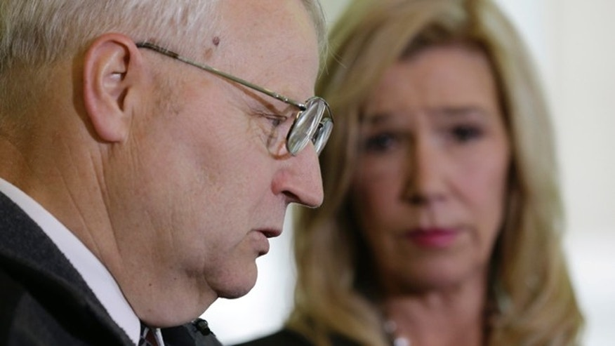 May 21, 2013: Chuck Cox, left, describes the search for his missing daughter as he stands with attorney Anne Bremner during a news conference, in Seattle.