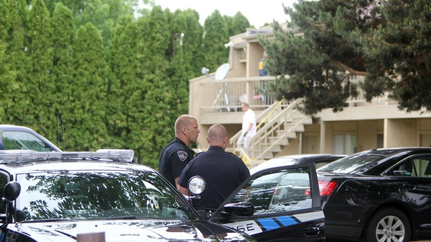 Federal authorities search an apartment in Boise, Idaho on Cassia Drive on Thursday afternoon, May 16 2013. U.S. authorities in Idaho said they have arrested a man from Uzbekistan accused of conspiring with a designated terrorist organization in his home country and helping scheme to use a weapon of mass destruction. Fazliddin Kurbanov, 30, was arrested at an apartment complex in south Boise on Thursday morning after a grand jury issued a three-count indictment as part of an investigation into his activities in Idaho and Utah. (AP Photo/The Idaho Statesman, Joe Jaszewski)