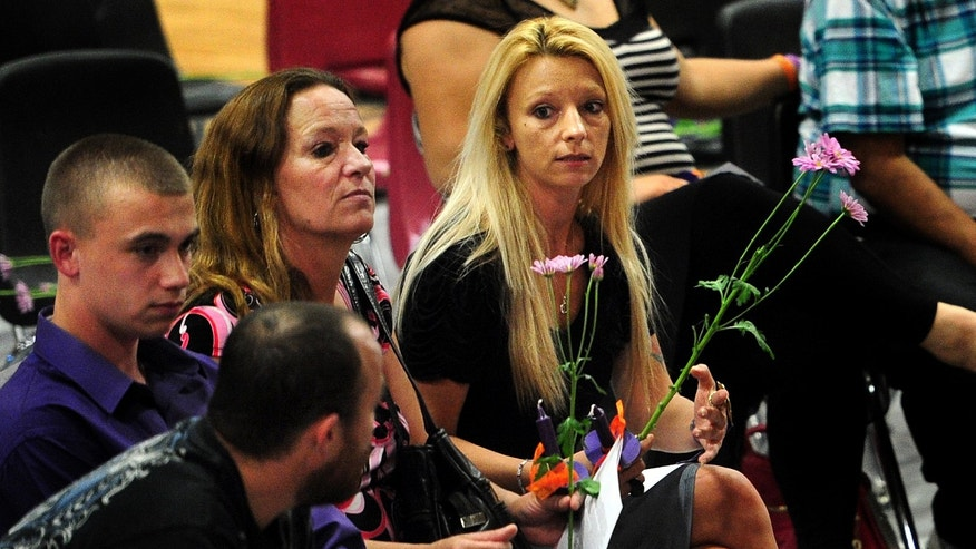 Family members of Hailey Darlene Dunn, including her mother, Billie Jean Dunn, right, grieve the teenager's loss during a public memorial service Sunday at Colorado Middle School in Colorado City, Texas. (AP Photo/The Abilene Reporter-News, Joy Lewis)