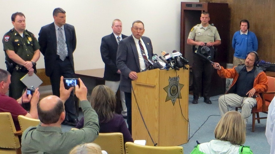 Penobscot County Sheriff Glenn Ross speaks at news conference Tuesday, May 21, 2013 in Bangor, Maine, where it was announced that Kyle Dube, of Orono, was charged with murder in the death of Nichole Cable, who was last seen May 12, 2013.  (AP Photo/David Sharp)