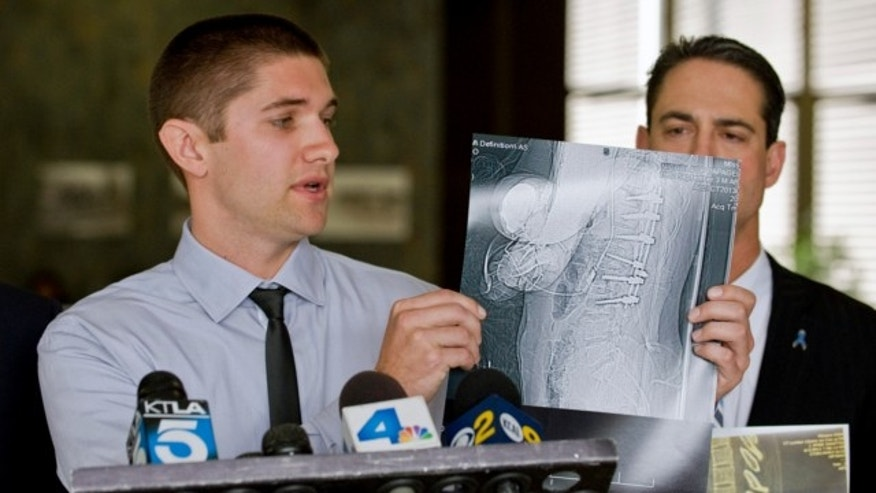 May 22, 2013: Nick Papageorge's, IV, 20, left, speaks during a news conference at superior court in Santa Ana, Calif., as Orange County Supervisor Todd Spitzer, right, looks on.