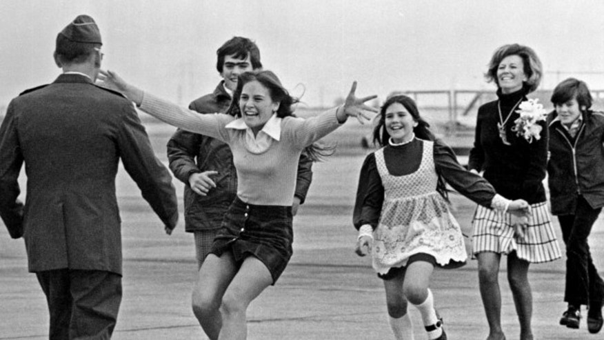 March 17, 1973: Released prisoner of war Lt. Col. Robert L. Stirm is greeted by his family at Travis Air Force Base in Fairfield, Calif., as he returns home from the Vietnam War.