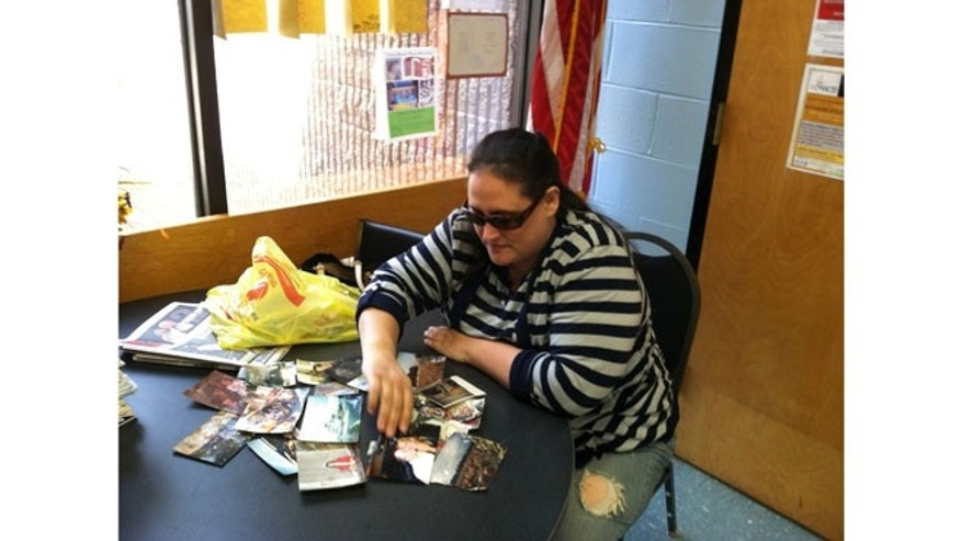 Jeannette Van Houten looks at recently found photos in Union Beach, NJ. To date, She, along with her volunteers, have found an estimated 20,000 photos over the past six months.