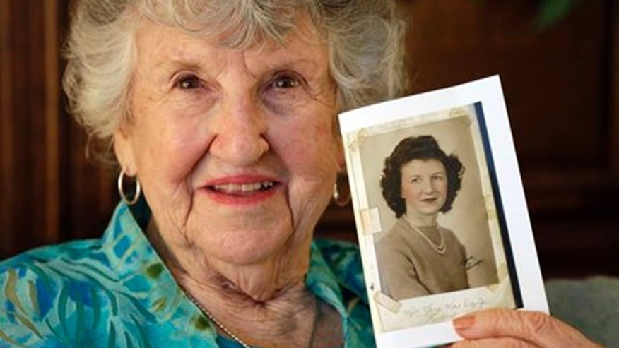 May 23, 2013: Laura Mae Davis Burlingame, 90, holds a photo of herself from high school, in her Moorseville, Ind. home.