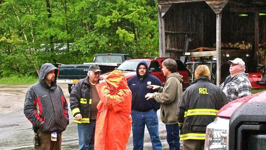 First responders gather at a staging point in Ephratah, N.Y., Saturday, May 25, 2013, before continuing their search for the pilot of a light plane that crashed in the wooded area day before. The twin engine plane was flown by an Angel Flight volunteer pilot and was carrying at least two passengers when it took off from Hanscom Field in Bedford, Mass., and was headed to Rome, N.Y. on Friday. Angel Flight is a nonprofit group that arranges free air transportation for sick patients from volunteer pilots. (AP Photo/The Daily Gazette, Bethany Bump) NO SALES