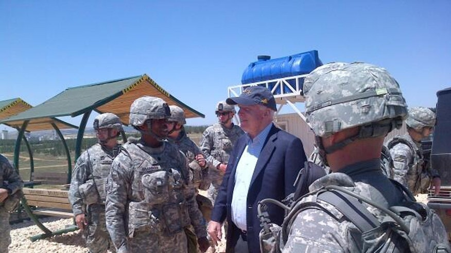 In this photo provided by U.S. Sen. John McCain, R-Ariz., on his Twitter site, McCain visits troops at a Patriot missile site in southern Turkey, Monday, May 27, 2013. McCain quietly slipped into Syria for a meeting with Syrian rebels on Monday, confirms spokeswoman Rachael Dean. She declined further comment about the trip. (AP Photo/John McCain via Twitter)
