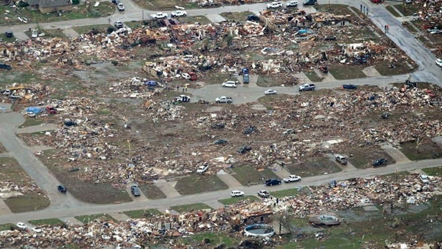 May 21, 2013: This aerial photo shows a residential area of Moore, Okla. destroyed by a tornado that roared through the Oklahoma City suburb Monday, flattening entire neighborhoods and destroying an elementary school with a direct blow as children and teachers huddled against winds.