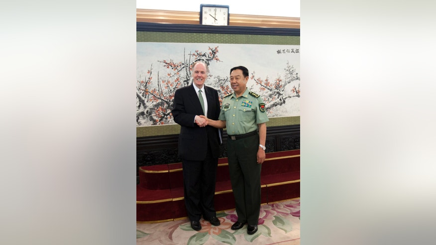 U.S. National Security Adviser Tom Donilon, left, poses with Gen. Fan Changlong, vice chairman of China's Central Military Commission, during their meeting at the Bayi Building, headquarters of Chinese Defense Ministry, in Beijing Tuesday, May 28, 2013. (AP Photo/Alexander F. Yuan, Pool)