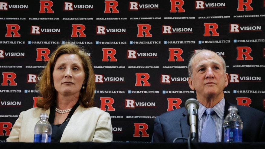 May 15, 2013: Julie Hermann, left, sits with Rutgers president Robert L. Barchi, as they listen to a question during a news conference where she was introduced as the new athletic director at Rutgers University in Piscataway, N.J. A high ranking official at the University of Tennessee has voiced her support for Hermann, who is facing allegations she verbally abused players while she was the volleyball coach with the Volunteers. (AP)