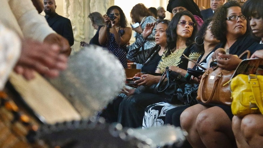 The Sheps Hetep drummers, left, play as the family of Malcolm Latif Shabazz, including his aunts Malaak Shabazz, seated fifth from right, and Ilyasah Shabazz, fourth from right, arrive for his memorial service at the First Corinthian Baptist Church on Thursday, May 30, 2013 in the Harlem section of New York.  Scores gathered to remember Shabazz, 28, the late grandson of slain civil rights leader Malcolm X, who authorities say was beaten to death in Mexico City.  (AP Photo/Bebeto Matthews)