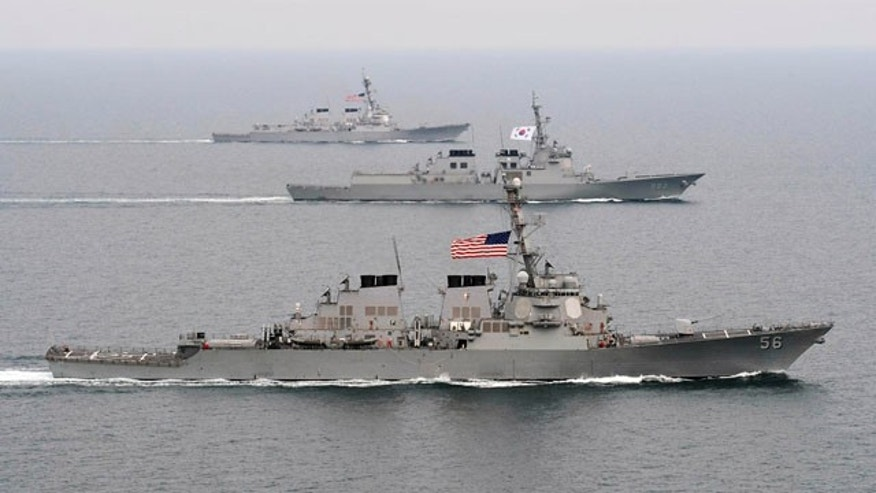 March 17, 2013: The Arleigh Burke-class guided-missile destroyer USS John S. McCain (DDG 56), foreground, the Republic of Korea Navy Aegis-class destroyer ROKS Seoae-Yu-Seong-Ryong (DDG 993), center, and the Arleigh Burke-class guided-missile destroyer USS McCampbell (DDG 85) move into formation during exercise Foal Eagle 2013 in the West Sea in South Korea.