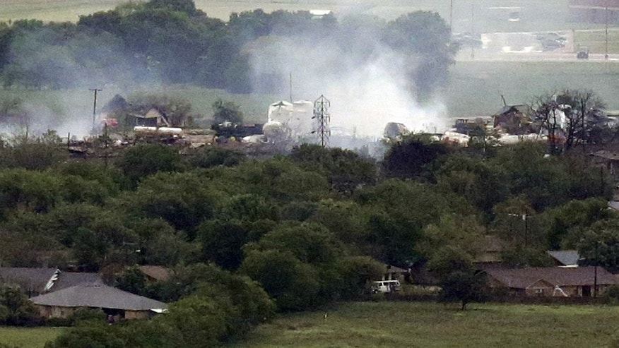 April 18, 2013: This file photo shows the remains of the the fertilizer plant smoldering in the rain at the at the West Fertilizer Co. in West, Texas after an explosion at the plant. Until the local fertilizer company in West, Texas, blew up last month and demolished scores of homes, many in that town of 2,800 didn't know what chemicals were stored alongside the railroad tracks or how dangerous they were. Even rescue workers didn't know what they were up against.