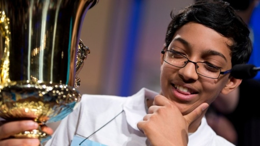 "May 30, 2013: Arvind Mahankali, 13, of Bayside Hills, N.Y., holds the championship trophy after he won the National Spelling Bee by spelling the word ""knaidel"" correctly in Oxon Hill, Md."