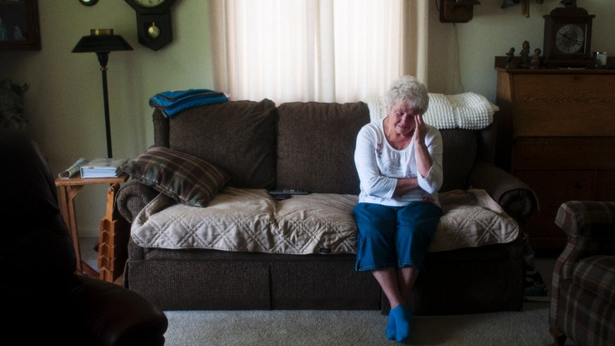 May 31, 2013: Burton resident Carole Mansfield, 72, cries at her home Friday morning in Burton, Mich., as she reflects on the life of her granddaughter Nicole Mansfield, who was killed in Syria on Wednesday by government forces.