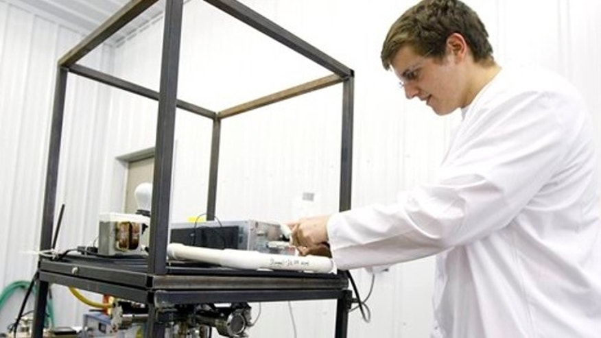 Jan. 17, 2013: Conrad Farnsworth, 18, demonstrates the fusion reactor he hand-built in his garage in Newcastle, Wyo.