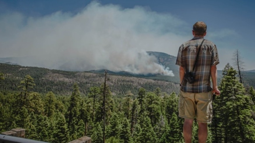 June 1, 2013: Jemez Springs resident Richard Middleton watches as the Thompson Ridge fire burns in an area just north of the town of Jemez Springs, New Mexico.