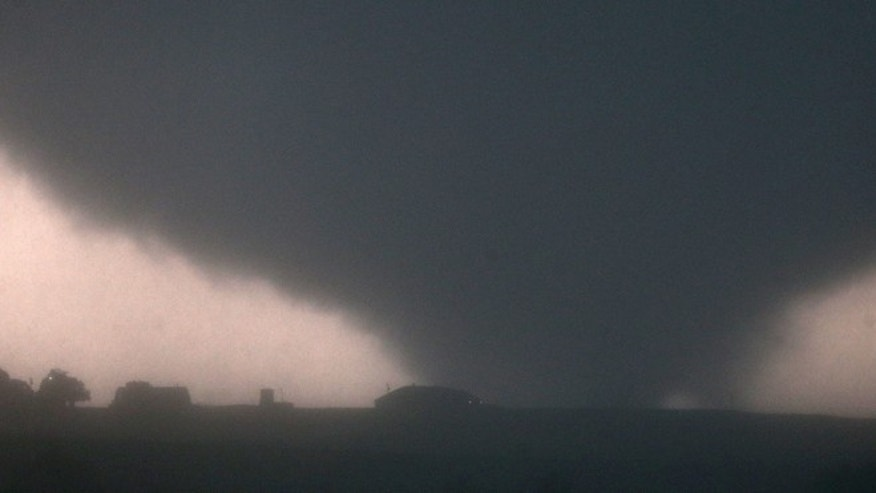 A tornado touches down near El Reno, Okla., Friday, May 31, 2013, causing damage to structures and injuring travelers on Interstate 40. I-40 has been closed after severe weather rolled through the area.