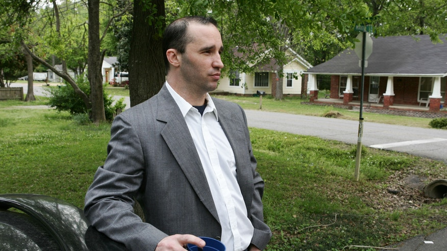 FILE - In this Tuesday April 23, 2013 file photo, Everett Dutschke stands in the street near his home in Tupelo, Miss., and waits for the FBI to arrive and search his home in connection with the sending of poisoned letters to President Barack Obama and others.  (AP Photo/Northeast Mississippi Daily Journal, Thomas Wells, File)