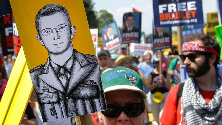 FILE: Saturday, June 1, 2013: Protesters march during a rally in support of Army Pfc. Bradley Manning outside of Fort Meade, Md.