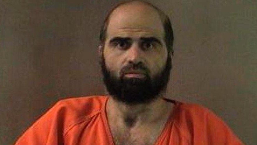 FILE: Nidal Hasan has been charged with killing 13 people and wounding 31 in a November 2009 shooting spree at Fort Hood.