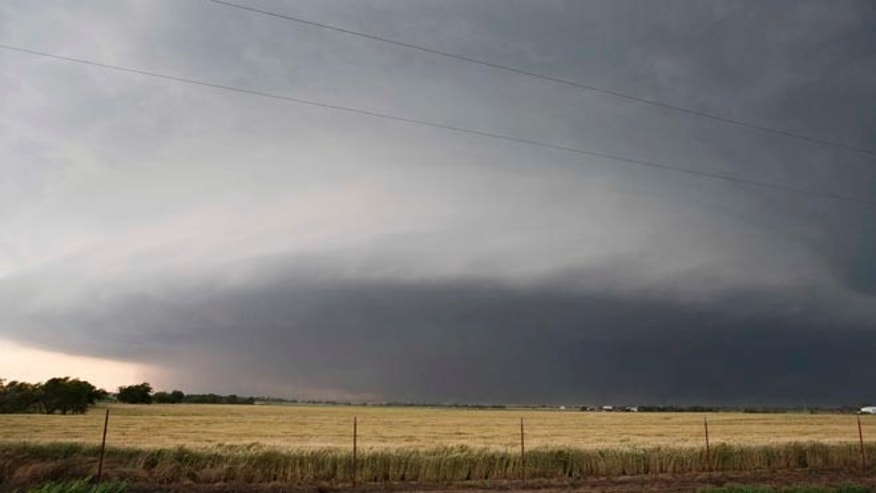 May 31, 2013: In this file photo a tornado forms near Banner Road and Praire Circle in El Reno, Okla. The National Weather Service says the deadly tornado that struck near Oklahoma City late last week was another top-of-the-scale EF5 that packed winds reaching 295 mph.
