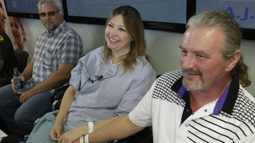 June 3: Jim Gerber, left, looks on as Lynette Hales and her husband Jeff Hales, right, speak with reporters following a news conference at the Intermountain Medical Center in Murray, Utah.