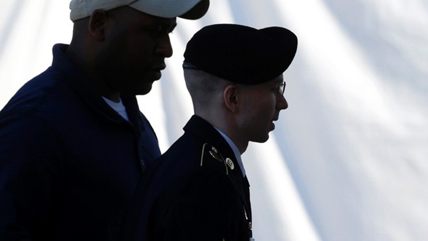 JUNE 4: Army Pfc. Bradley Manning is escorted into a courthouse in Fort Meade, Md.